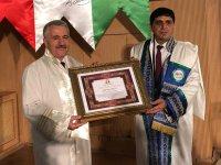 Iğdır Üniversitesi'nin ilk fahri doktorası Ahmet Arslan'a